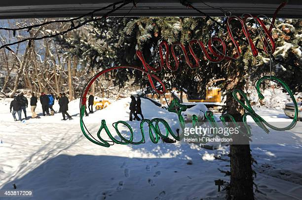 Merry Christmas neon sign hangs in the front entry way of a home on Evans street in Lyons , Co as Lyons mayor Julie Van Domelen points out flood...