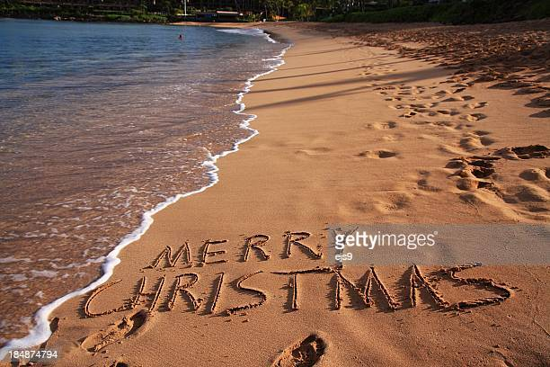 merry christmas on maui hawaii beach sand - hawaii christmas stock pictures, royalty-free photos & images