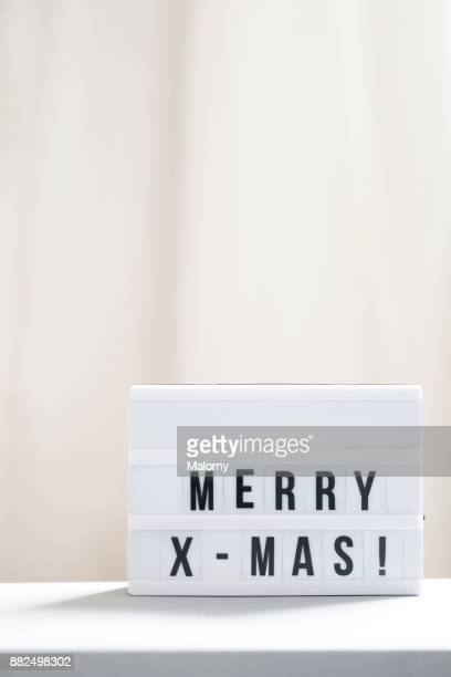 merry christmas or merry x-mas sign - lightbox stock pictures, royalty-free photos & images