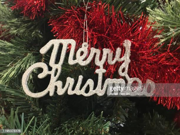 merry christmas sign - rafael ben ari stock-fotos und bilder