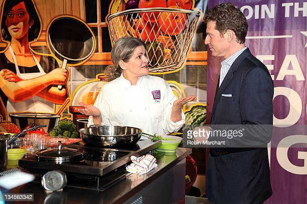Merry Graham and Chef Bobby Flay attend the Aetna Healthy Food Fight regional semifinal cookoff at ABC Studios on December 2 2011 in New York City