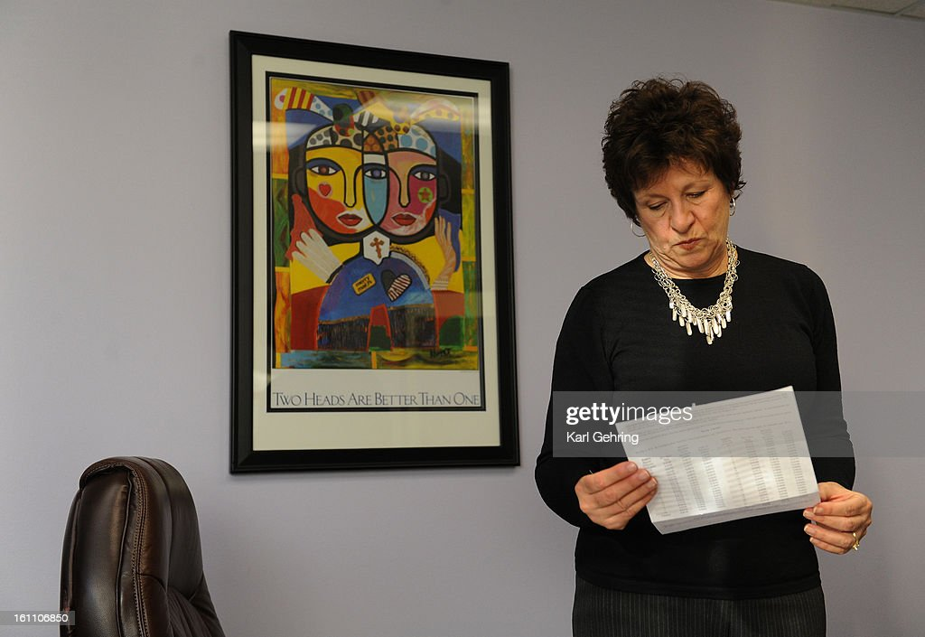Merry Maids North owner Linda Greene looked at the paperwork