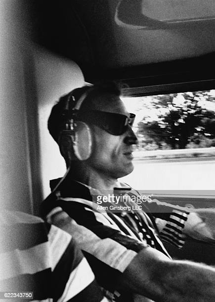 Merry Prankster Neal Cassady drives Ken Kesey's Further school bus on a crosscountry road trip to Timothy Leary's Millbrook estate