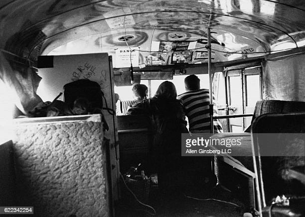 Merry Pranksters Neal Cassady and Ken Babbs ride in Ken Kesey's bus Further with a friend on the way to Timothy Leary's Castalia Foundation in...