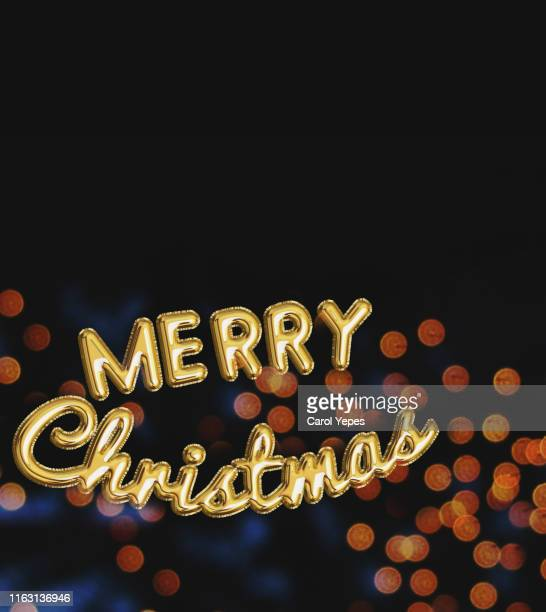 merry xmas message in gold balloon - christmas banner stock photos and pictures