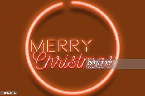 merry xmas message inneon text - christmas banner stock photos and pictures