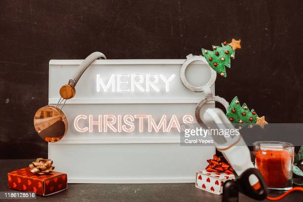 merry xmas message inneon text with podcast concept - christmas music stock pictures, royalty-free photos & images