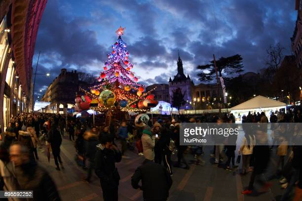 A merrygoround like a Christmas tree near the Capitole A Christmas market is placed on the main square of Toulouse the Capitole People come to buy a...