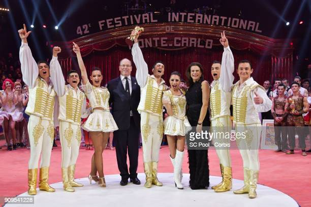 Merrylu and Jozsef Richter pose with Prince Albert II of Monaco and Princess Stephanie of Monaco after receiving a 'Golden Clown' during the Award...