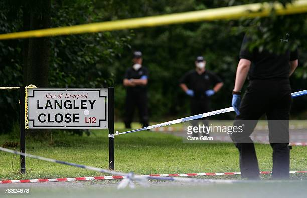 Merseyside Police work in an area which has been cordoned off after eleven year old Rhys Jones was the victim of a shooting in the area outside the...