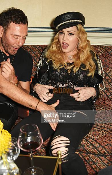 Mert Alas and Madonna attend Edward Enninful's OBE dinner at Mark's Club on October 27 2016 in London England