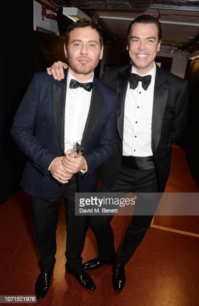 Mert Alas and Marcus Piggott, winners of the Isabella Blow Award for Fashion Creator, pose backstage at The Fashion Awards 2018 in partnership with...