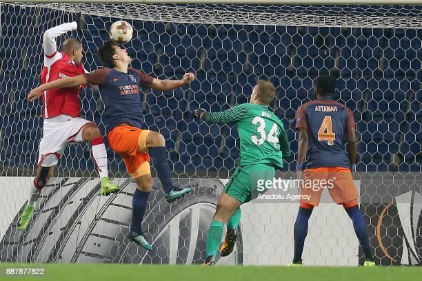 Mert Gunok of Medipol Basaksehir in action against Raul Silva of Braga during UEFA Europa League Group C soccer match between Medipol Basaksehir and...