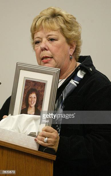 Merti Winstons holds a photo of her daughter Tracy Winston as she speaks at the sentencing of Gary Ridgway in King County Washington Superior Court...
