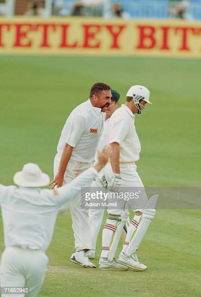 Merv Hughes of Australia dismisses Graeme Hick of England during the second innings of the first test between England and Australia at Old Trafford...