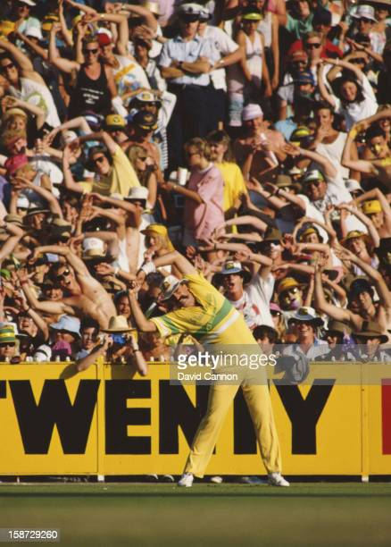 Merv Hughes of Australia does his warm up exercises in front of a following crowd at the BH World Series Cricket 1st Final against the West Indies on...