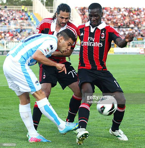 Mervan Celik of Pescara competes for the ball with Mario Yepes and Cristian Zapata of AC Milan during the Serie A match between Pescara and AC Milan...