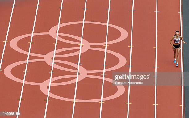 Merve Aydin of Turkey approaches the finish line after picking up an injury in the Women's 800m Round 1 Heats on Day 12 of the London 2012 Olympic...