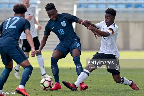 Merveille Papela of Germany U17 chalenges Arvin Appiah and Dylan Crowe of England U17 during U17Juniors Algarve Cup match between U17 Germany and U17...