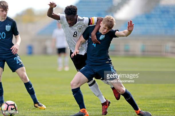 Merveille Papela of Germany U17 challenges Thomas Doyle of England U17 during U17Juniors Algarve Cup match between U17 Germany and U17 England at...