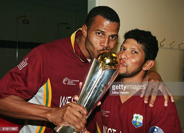 Mervyn Dillon and Ramnaresh Sarwan of the West Indies celebrate after the ICC Champions Trophy Final between England and the West Indies at the Brit...