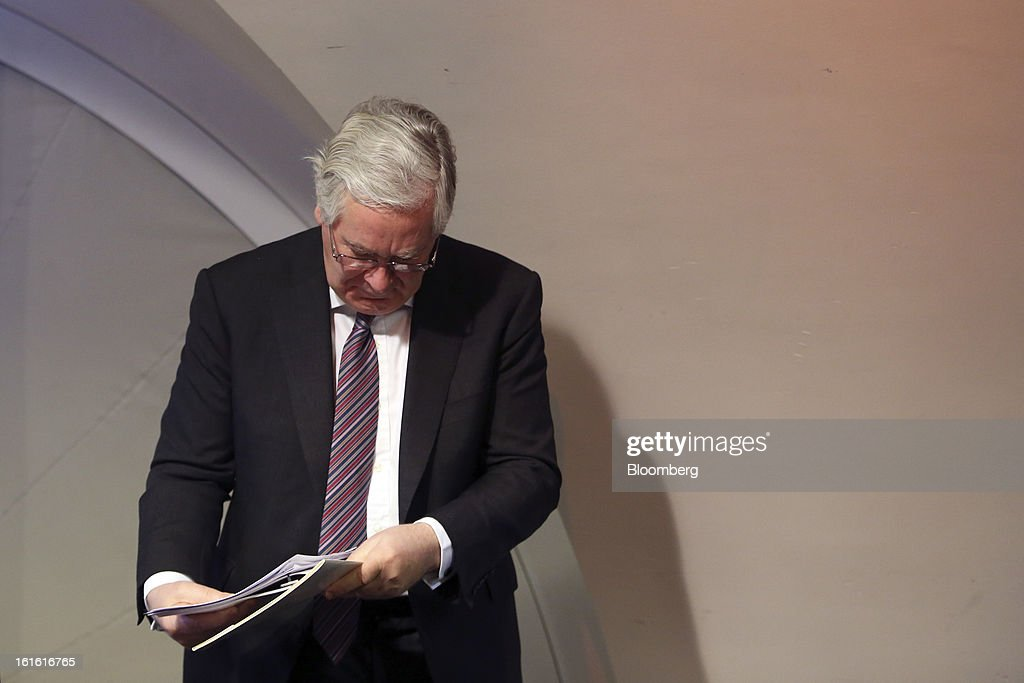 Mervyn King, governor of the Bank of England, gathers his papers following the bank's quarterly inflation report news conference at the Bank of England, in London, U.K., on Wednesday, Feb. 13, 2013. King said Britain faces a further bout of inflation and a muted economic recovery, and pledged officials will look through the volatility in prices to keep nurturing growth where they can. Photographer: Chris Ratcliffe/Bloomberg via Getty Images