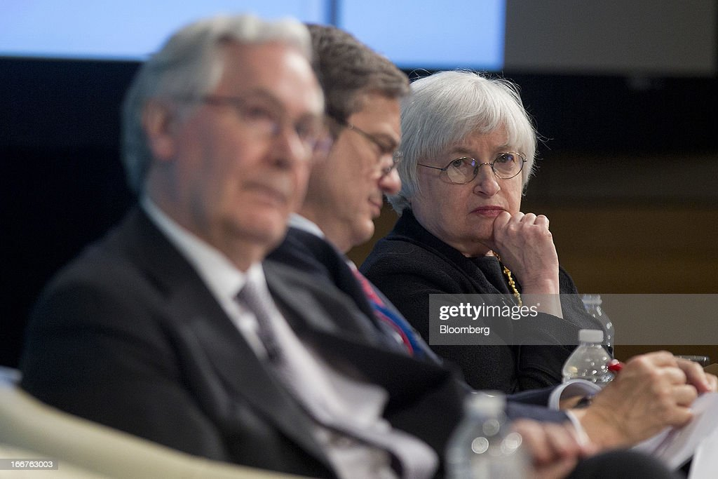 Mervyn King, governor of the Bank of England, left to right, Lorenzo Bini Smaghi, chairman of Snam SpA, and Janet Yellen, vice chairman of the U.S. Federal Reserve, listen at a macro policy discussion during the International Monetary Fund (IMF) and World Bank Group Spring Meetings in Washington, D.C., U.S., on Tuesday, April 16, 2013. The IMF cut its global growth forecast and urged European policy makers to use 'aggressive' monetary policy as a second year of contraction leaves the euro area's recovery lagging behind the rest of the world. Photographer: Andrew Harrer/Bloomberg via Getty Images