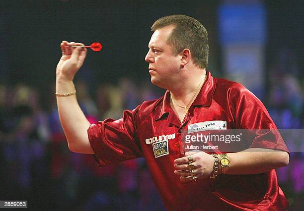 Mervyn King of England in action against Andy Fordham of England during the final of The BDO Lakeside World Darts Championships at the Lakeside on...