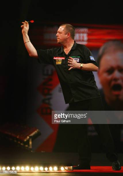 Mervyn King of England throws a dart during the second round match between Roland Scholten of Netherlands and Mervyn King of England during the 2008...