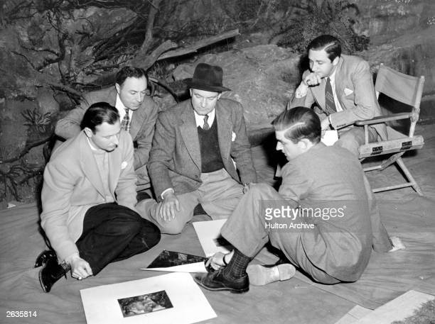 Mervyn Leroy the producer of Metro Goldwyn Mayer's all technicolour production of 'The Wizard Of Oz' is with Victor Fleming the director They are...