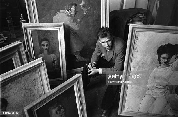 Mervyn Peake Britilish writer artist poet and illustrator sitting among a selection of his framed paintings December 1946 Picture Post 4276 An Artist...