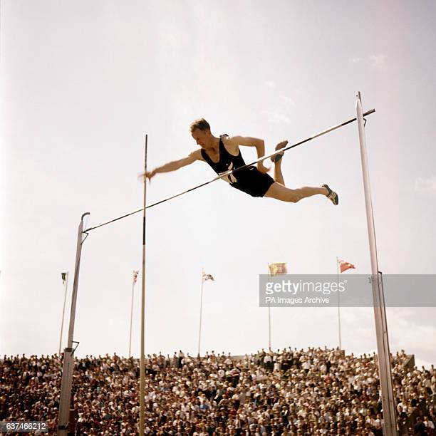 Mervyn Richards of New Zealand as he thrusts the pole away after clearing the bar