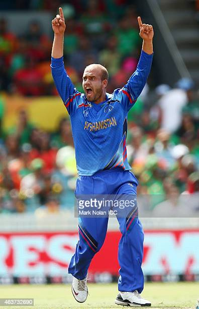 Merwais Ashraf of Afghanistan appeals successfully for the wicket of Anamul Haque of Bangladesh during the 2015 ICC Cricket World Cup match between...