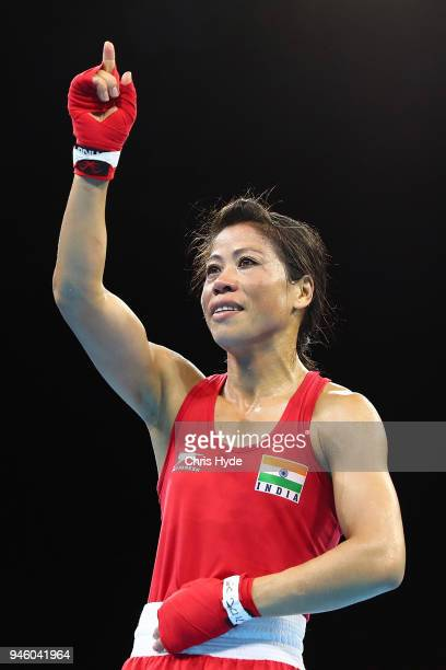 Mery Kom of India celebrates winning against Kristina O'Hara of Northern Ireland during the Womens's 4548kh Final Boxing Bout on day 10 of the Gold...