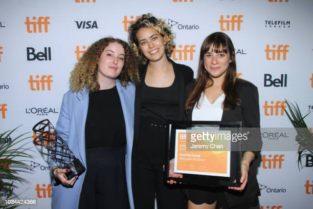 Meryam Joobeur and guests pose with the IWC Short Cuts Award for Best Canadian Short Film for 'Brotherhood' at the 2018 TIFF Awards Ceremony at TIFF...