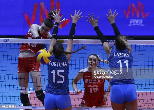 Meryem Boz of Turkey in action against Julieta Lazcano and Antonela Furtuna of Argentina during the FIVB Volleyball Nations League match between...