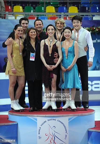 US Meryl Davis and Charlie White Canada's Tessa Virtue and Scott Moir and US Maia Shibutani and Alex Shibutani pose with their coaches Igor Shpilband...