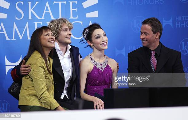 Meryl Davis and Charlie White celebrate with coach Marina Zueva after winning the Ice Dance during Hilton HHonors Skate America at Citizens Business...