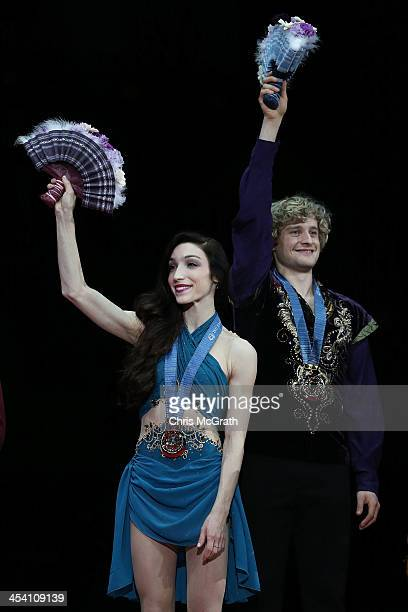 Meryl Davis and Charlie White of he USA wave to the crowd after receiving their medals during the victory ceremony for the Ice Dance Free Dance Final...