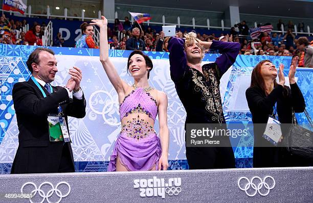 Meryl Davis and Charlie White of the United States celebrate the gold medal with their coaches Oleg Epstein and Marina Zoueva in the Figure Skating...