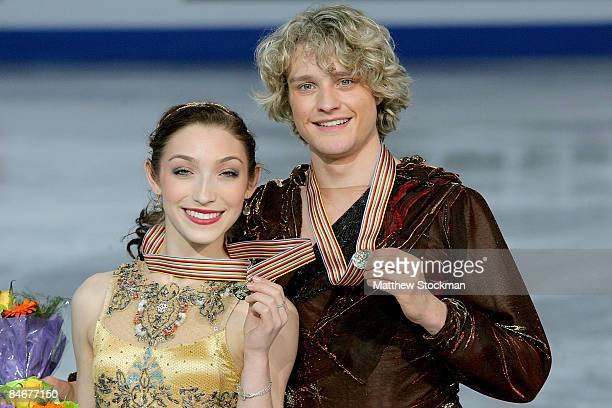 Meryl Davis and Charlie White of the United States pose for photographers after the Dance Free Skate during the ISU Four Continents Figure Skating...