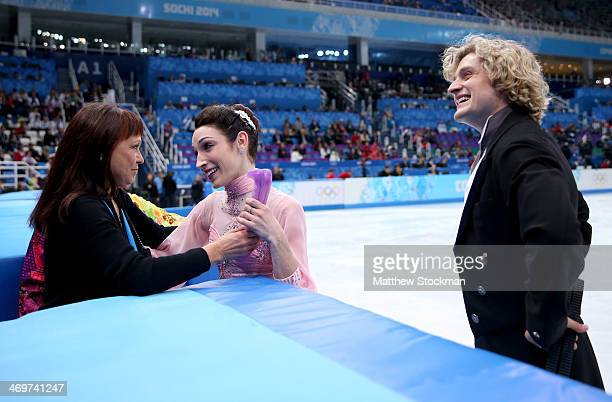Meryl Davis and Charlie White of the United States si welcomed by their coach Marina Zoueva after competing during the Figure Skating Ice Dance Short...