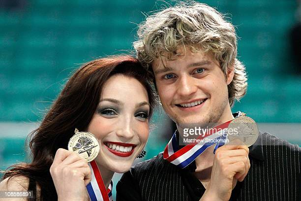 Meryl Davis and Charlie White pose for photographers after winning the Championship Dance competition during the U.S. Figure Skating Championships at...