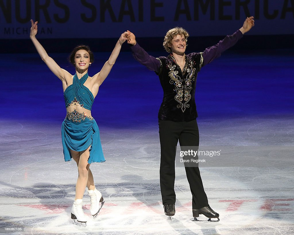 Meryl Davis (L) and Charlie White salute the crowd after winning gold medals in the free dance of day two at Skate America at Joe Louis Arena on October 19, 2013 in Detroit, Michigan.