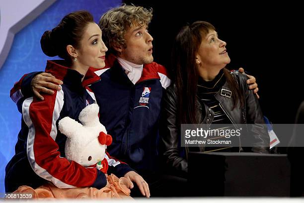 Meryl Davis Charlie White and their coach Marina Zoueva watch their scores after competing in the Ice Dance Short Dance during Skate America at Rose...