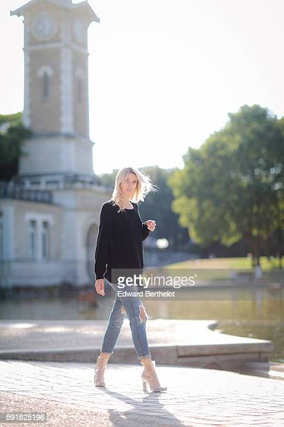 Meryl Denis is wearing a NAKD black pull over Hollister blue denim jeans pants and Public Desire transparent shoes on August 17 2016 in Paris France