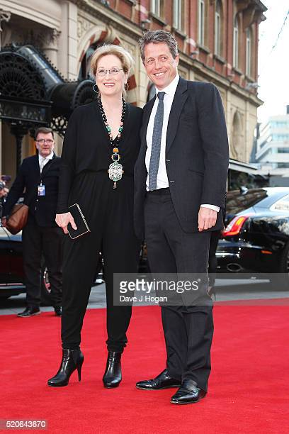 Meryl Streep and Hugh Grant arrive for the UK film premiere of Florence Foster Jenkins at Odeon Leicester Square on April 12 2016 in London England