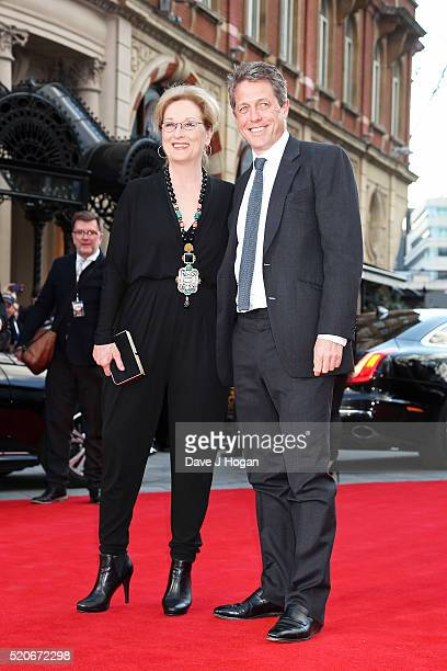 """Meryl Streep and Hugh Grant arrive for the UK film premiere of """"Florence Foster Jenkins"""" at Odeon Leicester Square on April 12, 2016 in London,..."""
