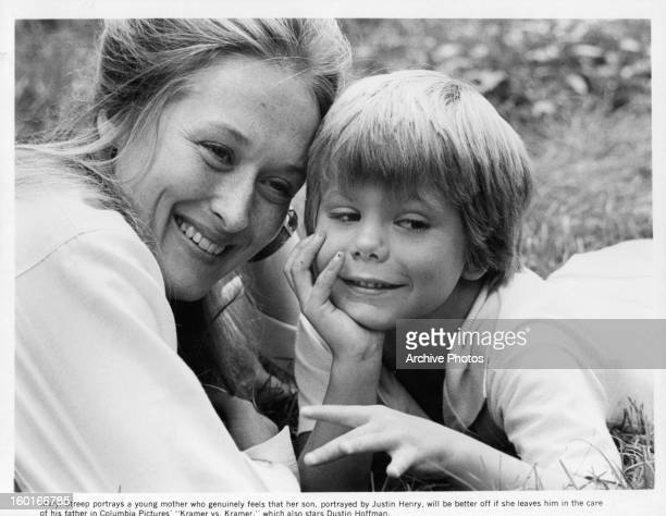 Meryl Streep lies in the grass with Justin Henry in a scene from the film 'Kramer Vs Kramer' 1979
