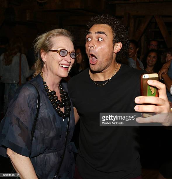 Meryl Streep visits Andrew Chappelle from the cast of 'Hamilton' backstage after a performance at the Richard Rodgers Theatre on August 13 2015 in...